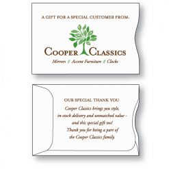 "Gift Card Envelope Style A Sleeve custom printed on white paper stock with Cooper Classics logo on the face in brown type and stylized green tree and a ""thank you"" message printed in brown on the back."